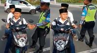 【印尼】小学生骑摩托被拦截 暴雨式哭泣求警察放过